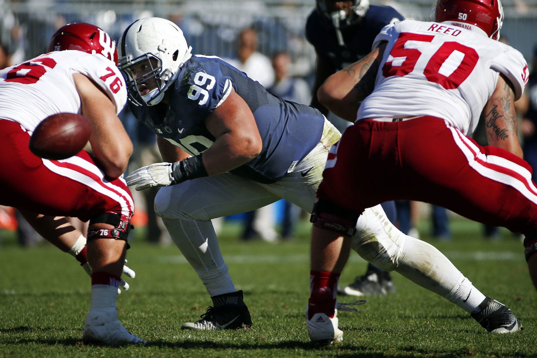 Penn State defensive tackle Austin Johnson (99) comes off the ball against Indiana offensive lineman Wes Martin (76)  during the second half of an NCAA college football game against Indiana in State College, Pa., Saturday, Oct. 10, 2015. Penn State won 29-7. (AP Photo/Gene J. Puskar)