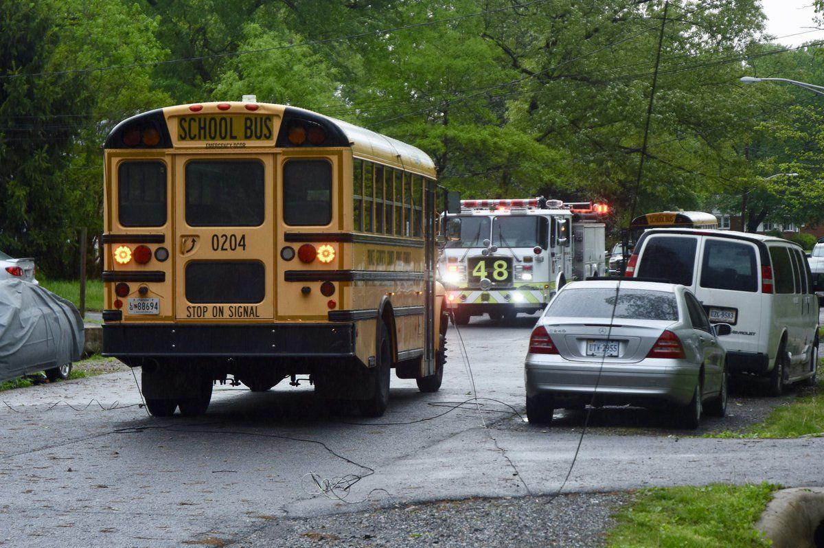 Wires were down on a Prince George's County Public Schools bus on Wellington Street after the storm. The kids were safely held on board as a precaution. (WTOP/Dave Dildine)