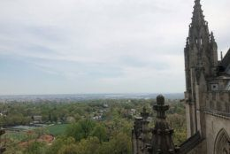 The Washington Monument is visible in the distance from atop the Washington National Cathedral. (WTOP/Mike Murillo)
