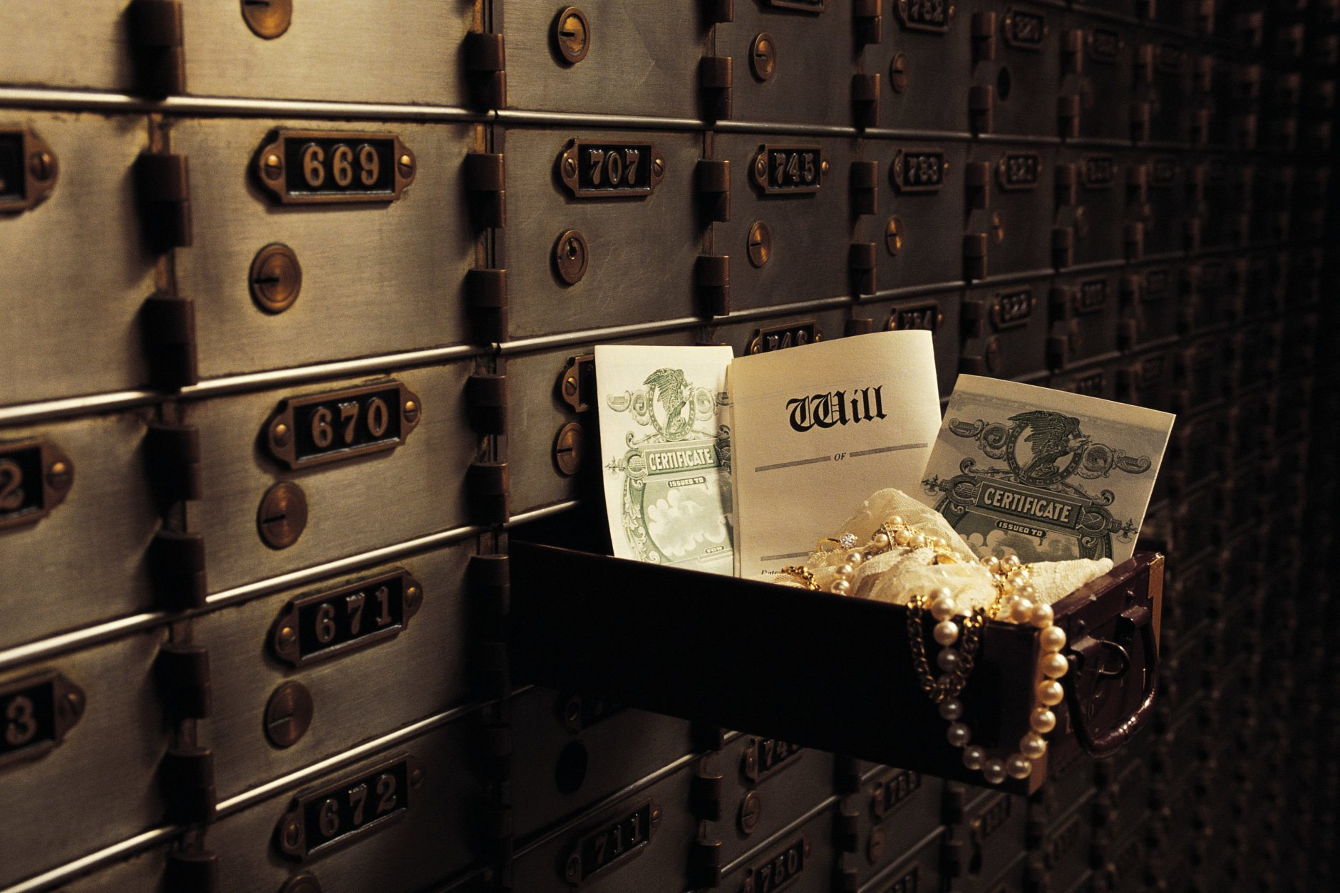 A safe deposit box is a small, secure container that's housed at a bank. The boxes can range in size from 2 inches by 5 inches to 10 inches by 15 inches or even larger. Costumers typically rent, and prices vary according to the bank and box size. (Getty Images/Comstock)