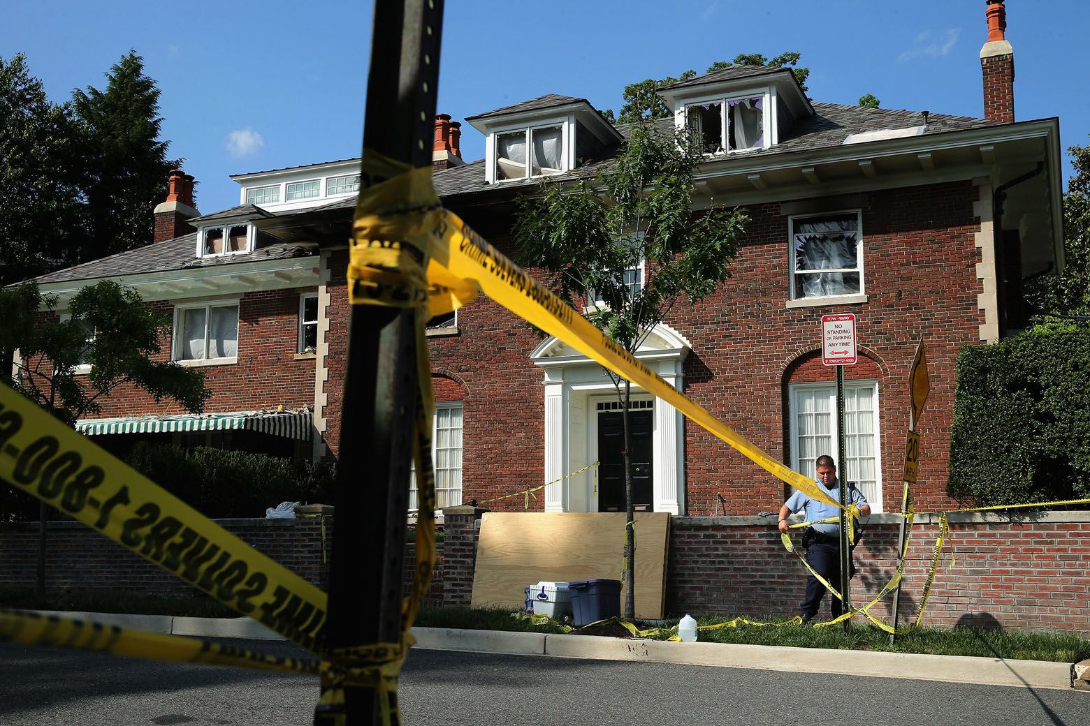 WASHINGTON, DC - MAY 19:  District of Columbia Metropolitan Police maintain a perimeter around the house on the 3200 block of Woodland Drive NW May 19, 2015 in Washington, DC. Firefighters discovered the bodies of Savvas Savopoulos, 46, his wife Amy, 47, their 10-year-old son Philip, and the housekeeper, Veralicia Figueroa, 57, last Thursday afternoon when they responded to a fire at the house. Two Savopoulos daughters were away in boarding school at the time. Investigators have ruled the deaths homicides and say they could continue to collect evidence at the house for another week. (Photo by Chip Somodevilla/Getty Images)