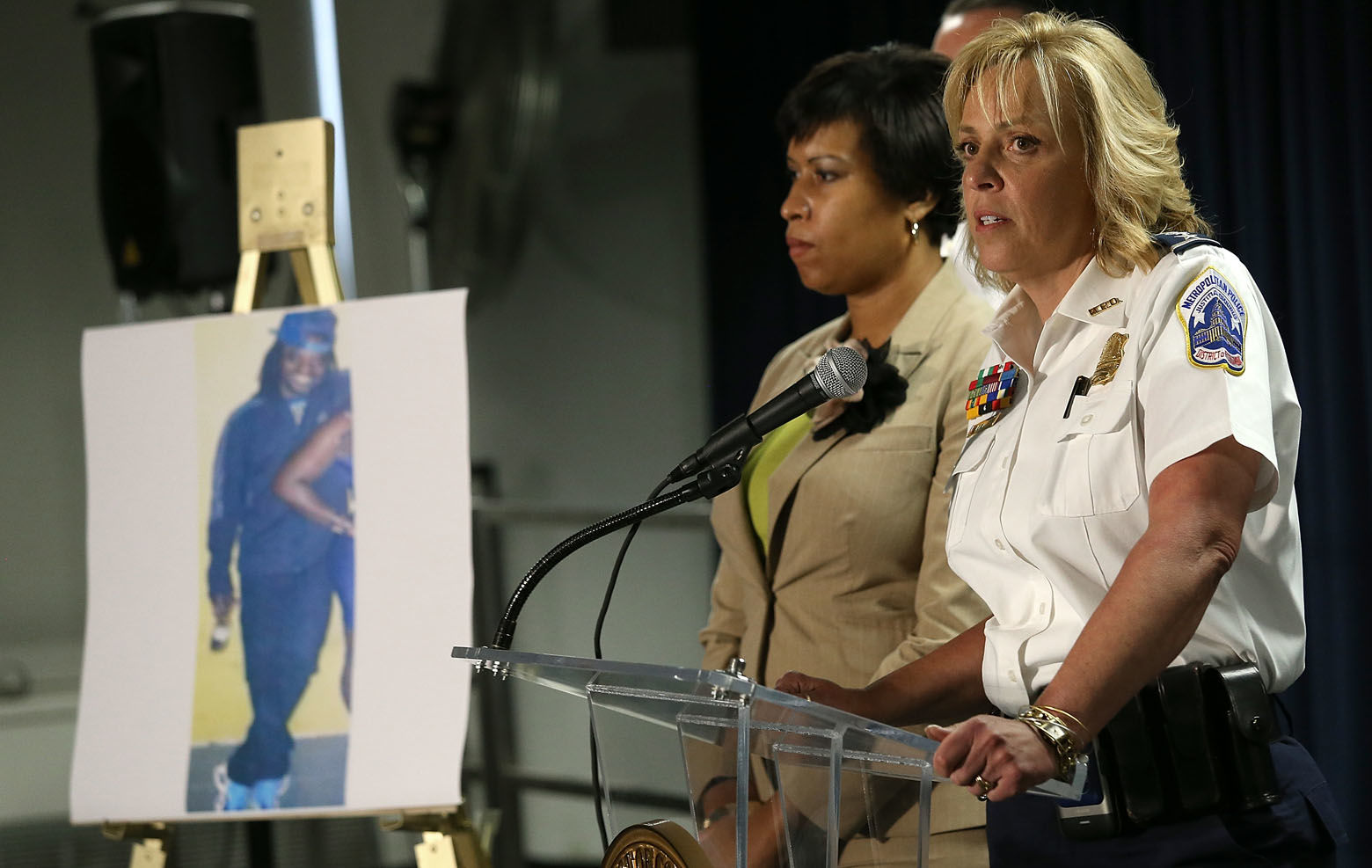 WASHINGTON, DC - MAY 21: Mayor Muriel Bowser (L) of Washington, DC listens as Chief of the Metropolitan Police Department Cathy Lanier (R) speaks at a press conference at police headquarters May 21, 2015 in Washington, DC. Bowser and Lanier asked the public for help in locating a suspect, Daron Dylon Wint, in a quadruple murder in the killing of Savvas Savopoulos and his family. Authorities believe Wint may have traveled to the Brooklyn, New York area. (Photo by Win McNamee/Getty Images)