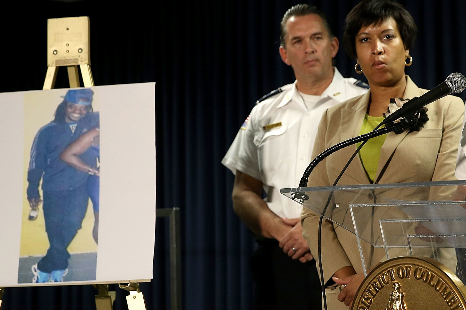 WASHINGTON, DC - MAY 21: Mayor Muriel Bowser (C) of Washington, DC listens as Chief of the Metropolitan Police Department Cathy Lanier (R) speaks at a press conference at police headquarters May 21, 2015 in Washington, DC. Bowser and Lanier asked the public for help in locating a suspect, Daron Dylon Wint, in a quadruple murder in the killing of Savvas Savopoulos and his family. Authorities believe Wint may have traveled to the Brooklyn, New York area. (Photo by Win McNamee/Getty Images)
