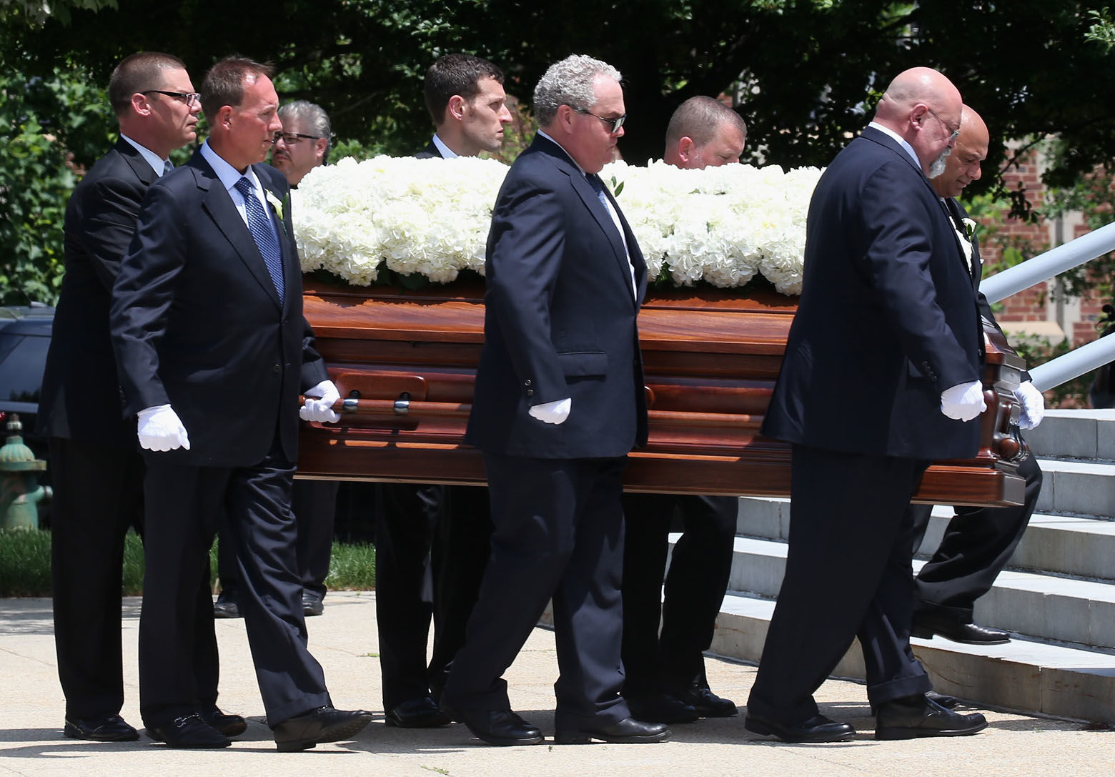 WASHINGTON, DC - JUNE 01: The casket of Savvas Savopoulos is carried during a funeral service at the Saint Sophia Greek Orthodox Cathedral June 1, 2015 in Washington, DC. Darron Dellon Dennis Wint, was arrested for the murders of Savvas Savopoulos, 46, his wife, Amy, 47, and their 10 year old son, Philip along with their housekeeper, Veralicia Figueroa, 57, who was killed with them.  (Photo by Mark Wilson/Getty Images)