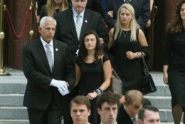 WASHINGTON, DC - JUNE 01:  Surviving daughters Katerina Marie Savopoulos (R) and Abigal Marie Savopoulos (L) folllow behind the casket of their 10-year old brother Philip Savopoulos after a funeral service the Saint Sophia Greek Orthodox Cathedral June 1, 2015 in Washington, DC. The funeral service was held for Savvas Savopoulos, 46, his wife, Amy, 47, and their 10 year old son, Philip who were murdered along with their housekeeper, Veralicia Figueroa, 57.  Darron Dellon Dennis Wint, was arrested and being held without bond for their murders.  (Photo by Mark Wilson/Getty Images)