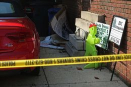 WASHINGTON, DC - MAY 19:  Crime scene tape sets a perimeter around a house on the 3200 block of Woodland Drive NW May 19, 2015 in Washington, DC. Firefighters discovered the bodies of Savvas Savopoulos, 46, his wife Amy, 47, their 10-year-old son Philip, and the housekeeper, Veralicia Figueroa, 57, last Thursday afternoon when they responded to a blaze at the house. Two Savopoulos daughters were away in boarding school at the time. Investigators have ruled the deaths homicides and say they could continue to collect evidence at the house for another week.  (Photo by Chip Somodevilla/Getty Images)