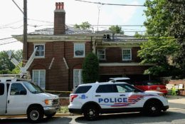 WASHINGTON, DC - MAY 19:  District of Columbia Metropolitan Police maintain a perimeter around the house on the 3200 block of Woodland Drive NW May 19, 2015 in Washington, DC. Firefighters discovered the bodies of Savvas Savopoulos, 46, his wife Amy, 47, their 10-year-old son Philip, and the housekeeper, Veralicia Figueroa, 57, last Thursday afternoon when they responded to a blaze at the house. Two Savopoulos daughters were away in boarding school at the time. Investigators have ruled the deaths homicides and say they could continue to collect evidence at the house for another week.  (Photo by Chip Somodevilla/Getty Images)
