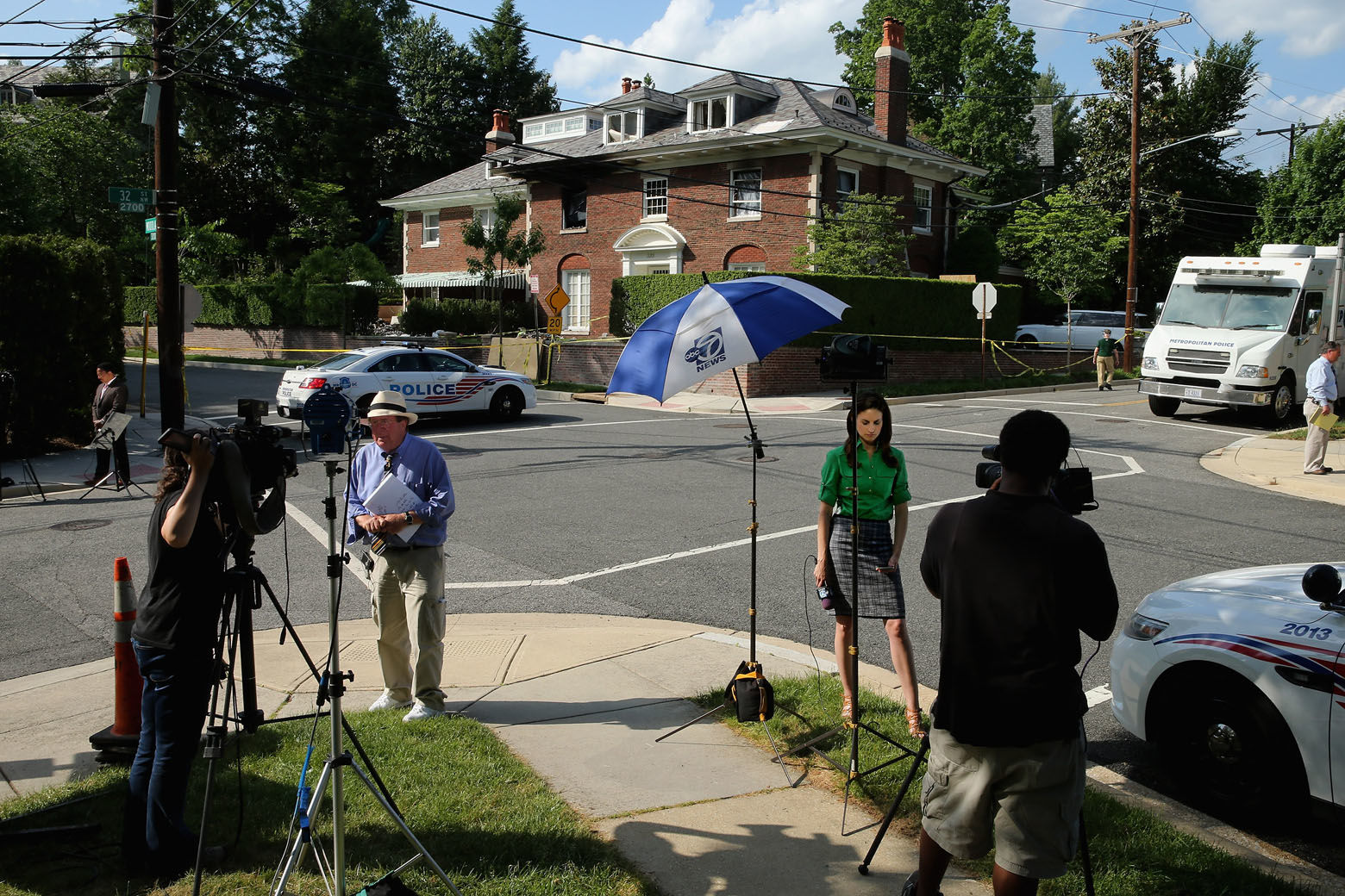 WASHINGTON, DC - MAY 19:  Television reporters and photographers set up across the street from a house on the 3200 block of Woodland Drive NW May 19, 2015 in Washington, DC. Firefighters discovered the bodies of Savvas Savopoulos, 46, his wife Amy, 47, their 10-year-old son Philip, and the housekeeper, Veralicia Figueroa, 57, last Thursday afternoon when they responded to a blaze at the house. Two Savopoulos daughters were away in boarding school at the time. Investigators have ruled the deaths homicides and say they could continue to collect evidence at the house for another week.  (Photo by Chip Somodevilla/Getty Images)