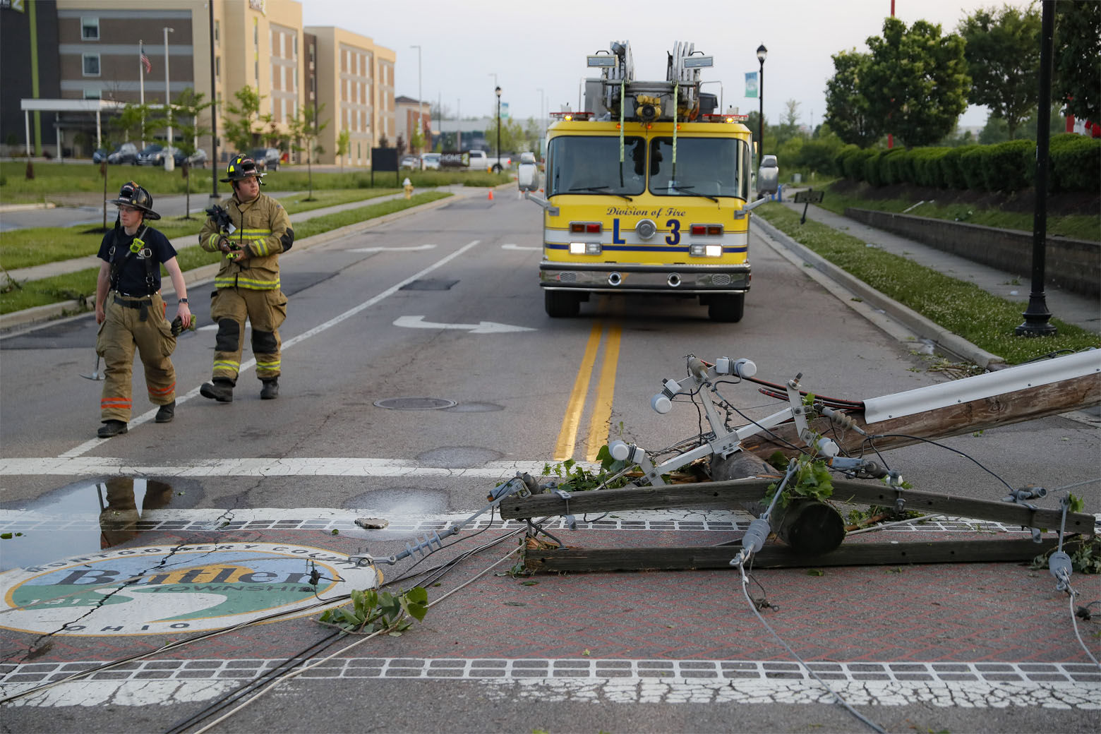 Storm damage litters a residential neighborhood, Tuesday, May 28, 2019, in Vandalia, Ohio. A rapid-fire line of apparent tornadoes tore across Indiana and Ohio overnight, packed so closely together that one crossed the path carved by another. (AP Photo/John Minchillo)