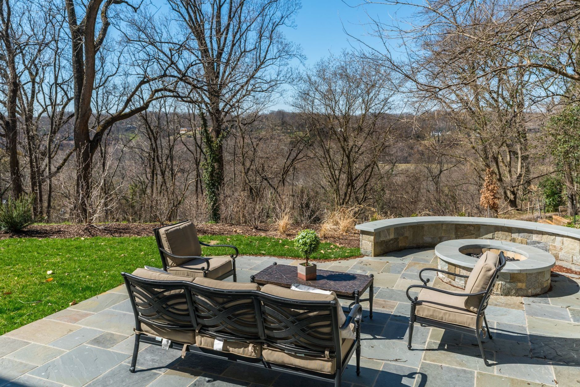 Sitting area and fire pit in the backyard. (Courtesy Wydler Brothers)