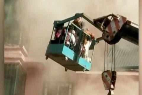 WATCH: Teenage crane operator saves 14 people trapped by fire