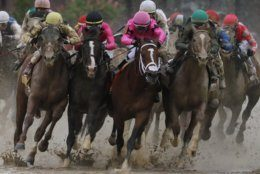 Flavien Prat on Country House, left, races against Luis Saez on Maximum Security, third from left, during the 145th running of the Kentucky Derby horse race at Churchill Downs Saturday, May 4, 2019, in Louisville, Ky. Maximum Security was disqualified and Country House won the race. (AP Photo/John Minchillo)