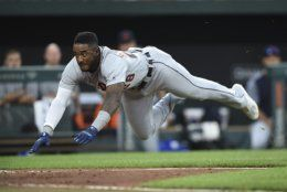 Detroit Tigers 'Niko Goodrum dives for home plate on a double by Nicholas Castellanos against the Baltimore Orioles in the fourth inning of a baseball game Wednesday, May 29, 2019, in Baltimore. Goodrum was safe. (AP Photo/Gail Burton)
