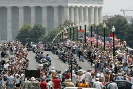 "Tens of thousands of motorcycles roar across the Memorial Bridge with the Lincoln Monument in the background, as a part of the annual ""Rolling Thunder"" motorcycle ride, Sunday May 28, 2006, in Washington. The ride, which honors the nation's veterans, circles through downtown Washington and ends at the Vietnam Veterans Memorial. Bikers will hold their last Rolling Thunder ride in D.C. in 2019. (AP Photo/Lawrence Jackson)"
