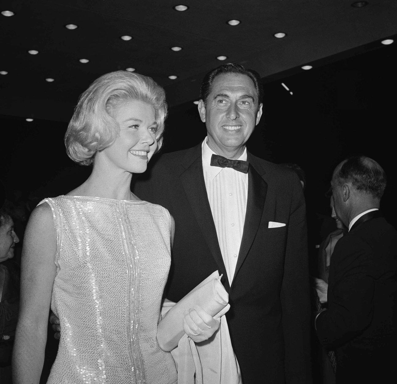 "FILE - In this April 4, 1960 file photo, Doris Day, a best actress of the year nominee for her role in ""Pillow Talk,"" and her producer husband Marty Melcher, arrive for the annual Academy Award Oscar presentations at the Pantages Theater in Los Angeles. The film and recording star Day is marking her 95th birthday Monday, April 3, 2017, with a social media campaign to highlight her love of animals. (AP Photo, File)"
