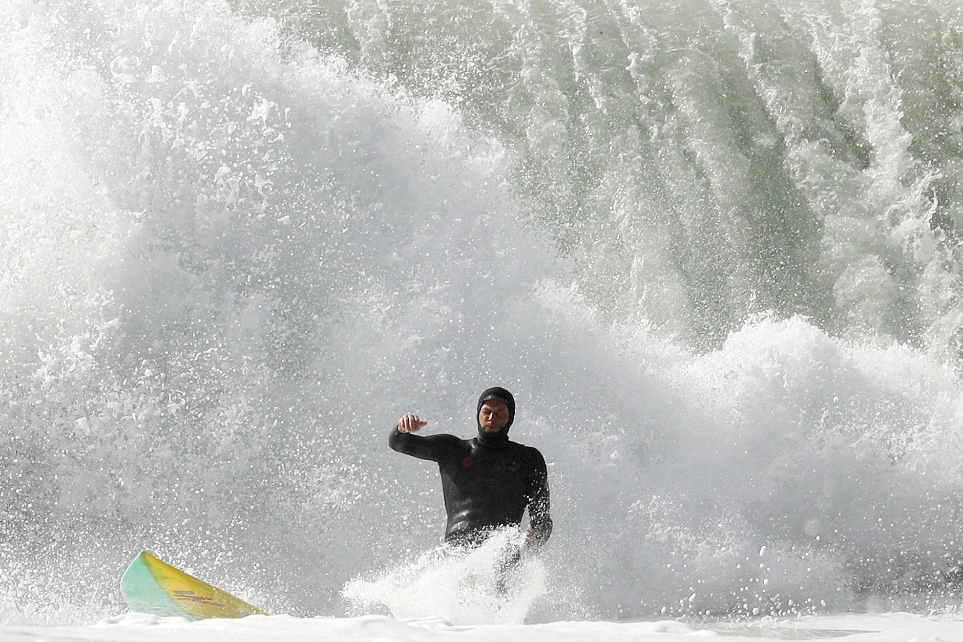 A surfer falls on a wave at Blacks Beach Friday, Jan. 19, 2018, in San Diego. A winter storm swept into California Friday, bringing large waves to the coast, and much-needed snow in higher elevations of the Sierra Nevada. (AP Photo/Gregory Bull)