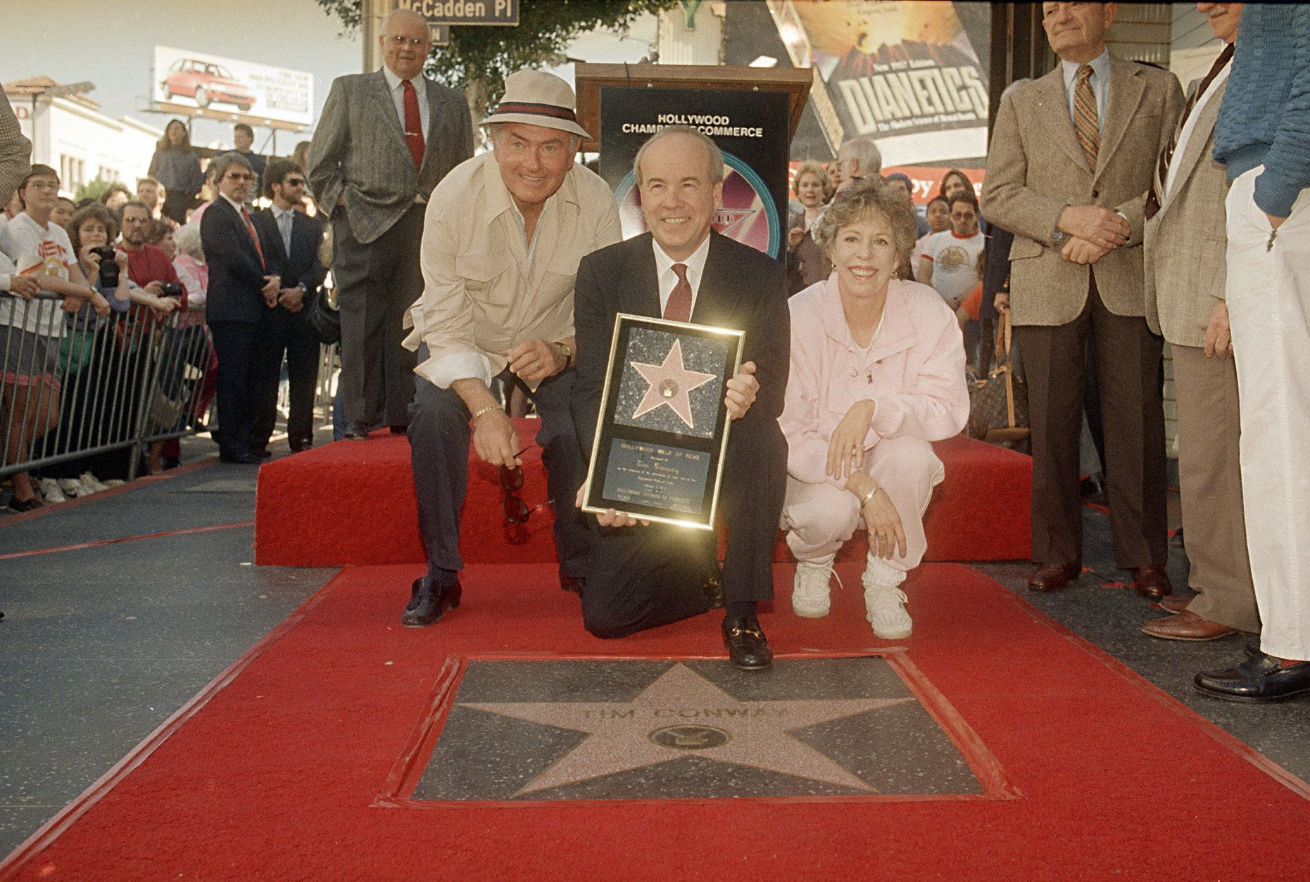 Comedian Tim Conway, flanked by Harvey Korman and Carol Burnett, receives his star on the Hollywood Walk of Fame, Feb. 21, 1989.  (AP Photo/Mark J. Terrill)