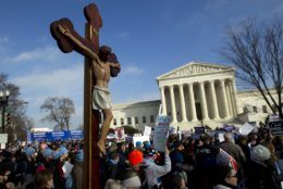 FILE - In this Friday, Jan. 18, 2019 file photo, anti-abortion activists march outside the U.S. Supreme Court building, during the March for Life in Washington. The anti-abortion movement's clout in many state legislatures has now been amplified by Donald Trump's election as president after he promised to support the movement's key goals. (AP Photo/Jose Luis Magana)