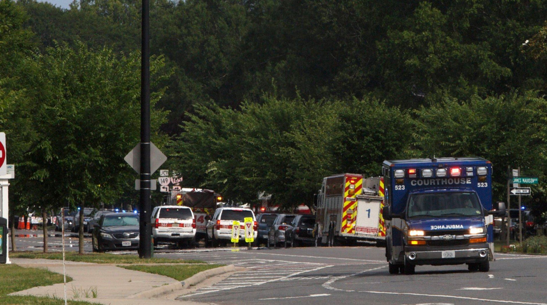 Emergency vehicle are seen near the intersection of Princess Anne Road and Nimmo Parkway following a shooting at the Virginia Beach Municipal Center on Friday, May 31, 2019 in Virginia Beach, Va. At least one shooter wounded multiple people at a municipal center in Virginia Beach on Friday, according to police, who said a suspect has been taken into custody. (Kaitlin McKeown/The Virginian-Pilot via AP)