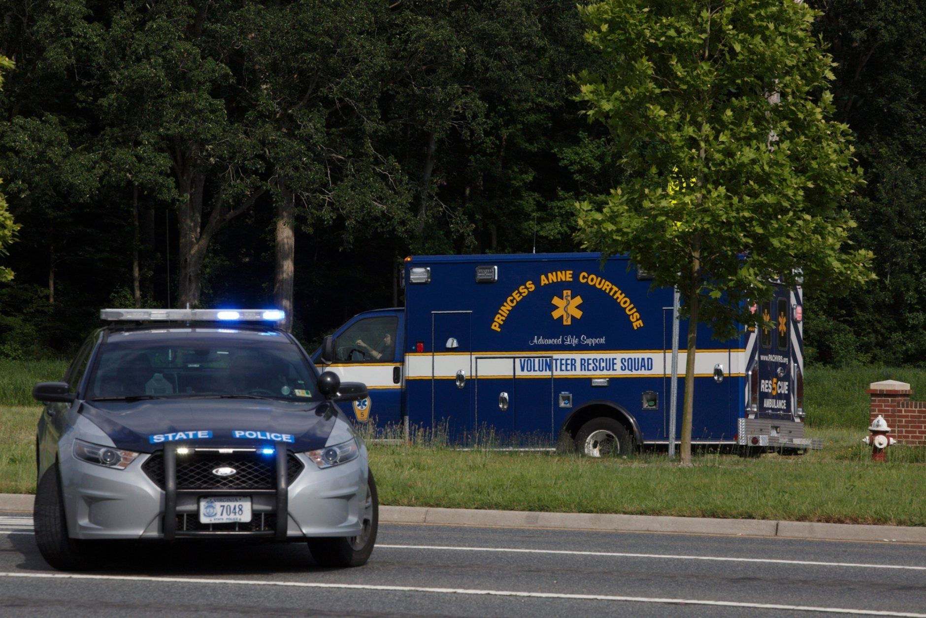 An ambulance turns on Nimmo Parkway following a shooting at the Virginia Beach Municipal Center on Friday, May 31, 2019, in Virginia Beach, Va. At least one shooter wounded multiple people at a municipal center in Virginia Beach on Friday, according to police, who said a suspect has been taken into custody. (Kaitlin McKeown/The Virginian-Pilot via AP)