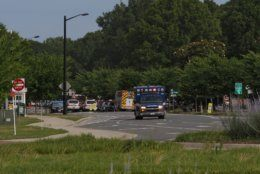 Emergency vehicles respond near the intersection of Princess Anne Road and Nimmo Parkway following a shooting at the Virginia Beach Municipal Center on Friday, May 31, 2019, in Virginia Beach, Va. At least one shooter wounded multiple people at a municipal center in Virginia Beach on Friday, according to police, who said a suspect has been taken into custody. (Kaitlin McKeown/The Virginian-Pilot via AP)