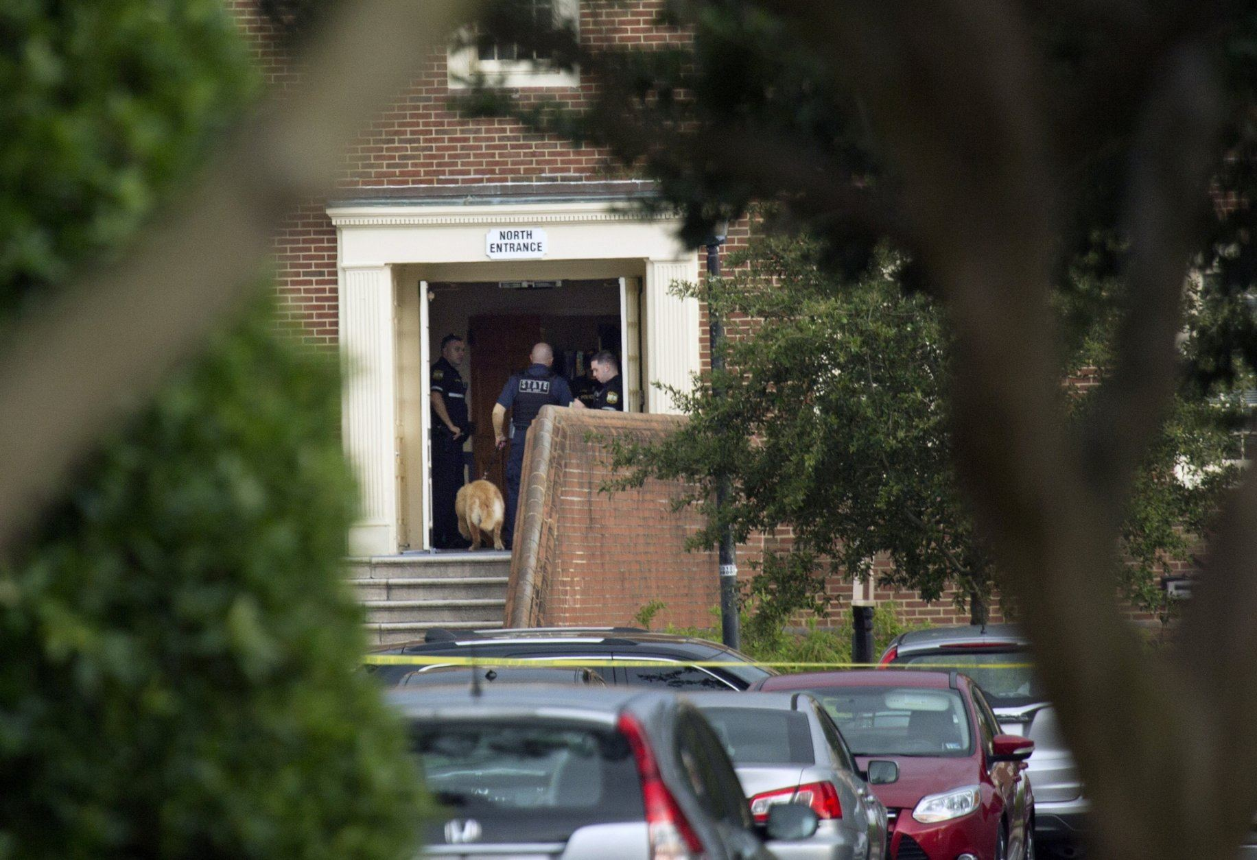 Police work the scene where eleven people were killed during a mass shooting at the Virginia Beach city public works building, Friday, May 31, 2019 in Virginia Beach, Va. A longtime, disgruntled city employee opened fire at a municipal building in Virginia Beach on Friday, killing 11 people before police fatally shot him, authorities said.  Six other people were wounded in the shooting, including a police officer whose bulletproof vest saved his life, said Virginia Beach Police Chief James Cervera. (L. Todd Spencer/The Virginian-Pilot via AP)