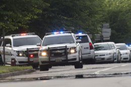 Police work the scene of a mass shooting at the Virginia Beach city public works building Friday, May 31, 2019 in Virginia Beach, Va. A longtime city employee opened fire at a municipal building in Virginia Beach on Friday, killing 11 people before police shot and killed him, authorities said. Six other people were wounded in the shooting, including a police officer whose bulletproof vest saved his life, said Virginia Beach Police Chief James Cervera. (L. Todd Spencer/The Virginian-Pilot via AP)