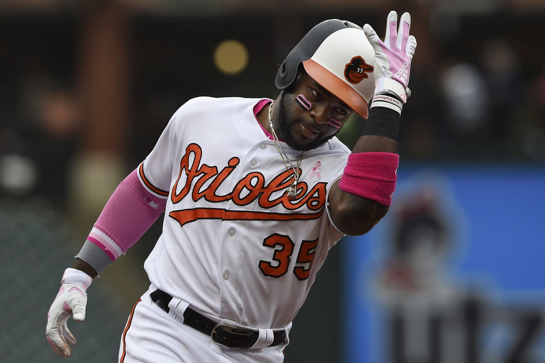 Baltimore Orioles' Dwight Smith Jr. pats his helmet while rounding third on his two-run home run against the Los Angeles Angels in the third inning of a baseball game, Sunday, May 12, 2019, in Baltimore. (AP Photo/Gail Burton)