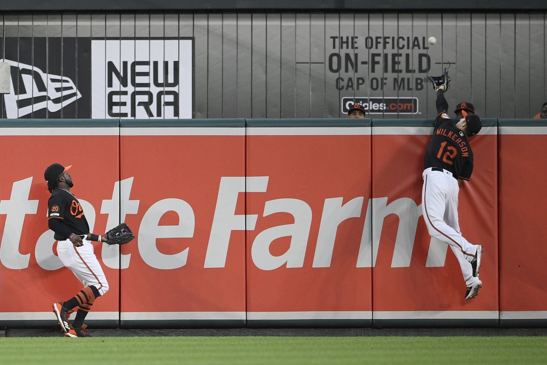 Baltimore Orioles center fielder Stevie Wilkerson (12) leaps in vain for a two-run home run by Los Angeles Angels' Mike Trout during the third inning of a baseball game Friday, May 10, 2019, in Baltimore. Dwight Smith Jr. is at left. (AP Photo/Nick Wass)