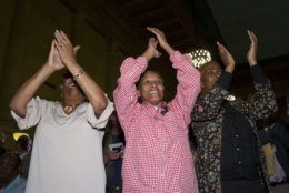 "People cheer at the swearing-in ceremony for new Baltimore Mayor Bernard ""Jack"" Young at the War Memorial Building in Baltimore, Thursday, May 9, 2019. Former Mayor Catherine Pugh resigned under pressure, amid a flurry of investigations into whether she arranged bulk sales of her self-published children's books to disguise hundreds of thousands of dollars in kickbacks. (AP Photo/Jose Luis Magana)"