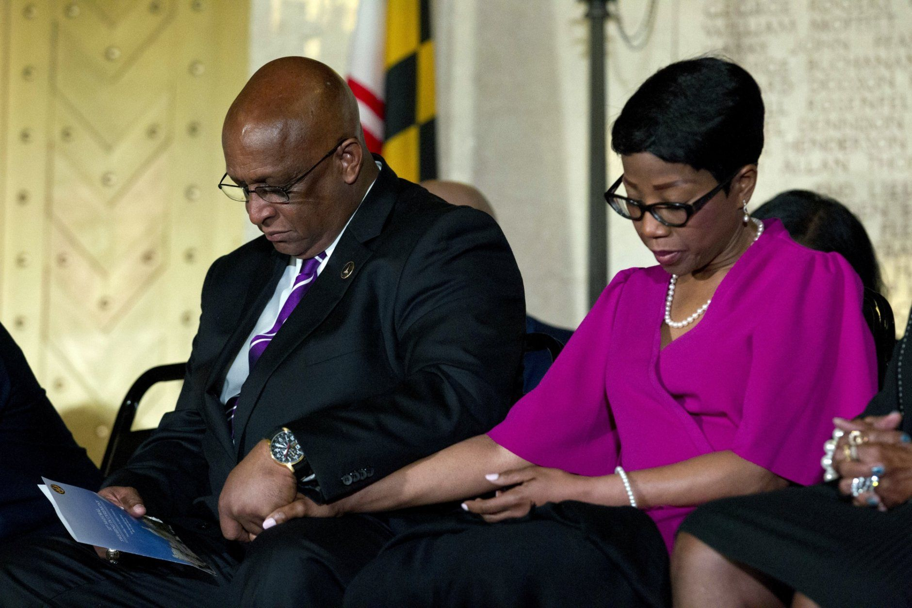 "Baltimore Mayor Bernard ""Jack"" Young holds the hand of his wife, Darlene Young, during a prayer at his swearing-in ceremony at the War Memorial Building in Baltimore, Thursday, May 9, 2019. Former Mayor Catherine Pugh resigned under pressure, amid a flurry of investigations into whether she arranged bulk sales of her self-published children's books to disguise hundreds of thousands of dollars in kickbacks. (AP Photo/Jose Luis Magana)"