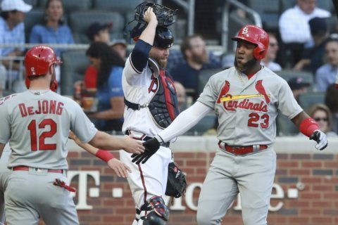 Cards hit 4 HRs to support Flaherty in 14-3 win over Braves