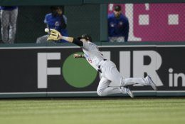 Chicago Cubs center fielder Albert Almora Jr. (5) dives for and catches a line drive by Washington Nationals' Juan Soto for an out during the ninth inning of a baseball game, Friday, May 17, 2019, in Washington. (AP Photo/Nick Wass)