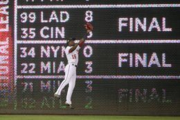 Washington Nationals center fielder Victor Robles (16) leaps up to catch a line drive by Chicago Cubs' Addison Russell for an out during the ninth inning of a baseball game, Sunday, May 19, 2019, in Washington. The Cubs won 6-5. (AP Photo/Nick Wass)
