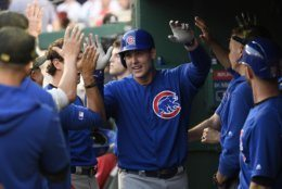 Chicago Cubs' Anthony Rizzo celebrates his home run in the dugout during the third inning of a baseball game against the Washington Nationals, Sunday, May 19, 2019, in Washington. (AP Photo/Nick Wass)