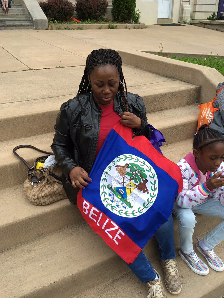 A woman rests with her children while participating in the Embassy Walk on May 4, 2019. (WTOP/Liz Anderson)