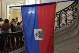The flag of Haiti hangs in the Haitian Embassy on May 4, 2019. (WTOP/Liz Anderson)