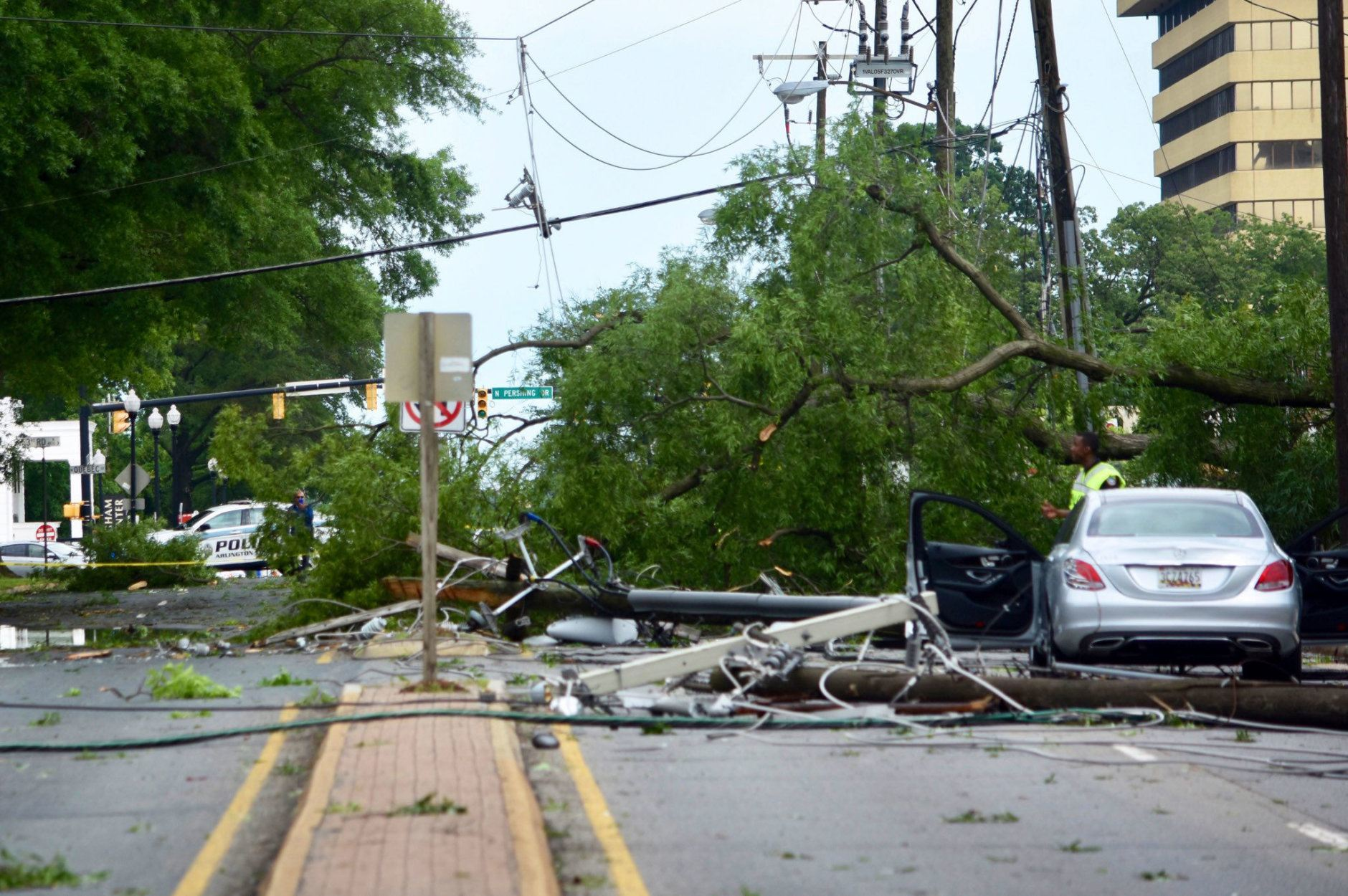 Glebe Road is blocked between Henderson Road and U.S. 50, and is expected to stay that way for hours after Thursday's storm blew down a live oak tree and three poles, along with their wires. (WTOP/Dave Dildine)