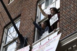 Four activists remained in the Venezuelan Embassy on Tuesday evening, resisting an order by federal law enforcement to leave or face arrest. (WTOP/Alejandro Alvarez)