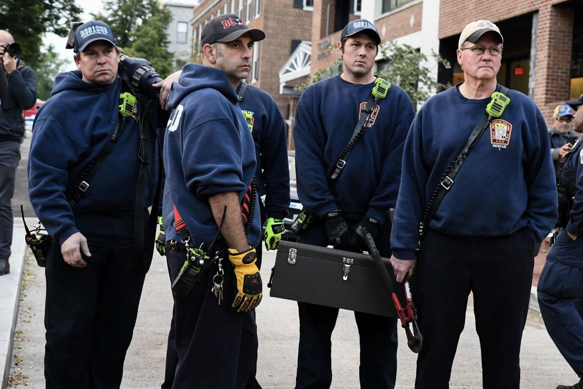 The D.C. fire department arrived with bolt cutters to remove chains and a bike lock which activists had sealed the Venezuelan Embassy's front entrance with. (WTOP/Alejandro Alvarez)