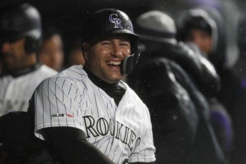 Iannetta homers in 7th, Rox beat D'backs 6-2 on rainy night
