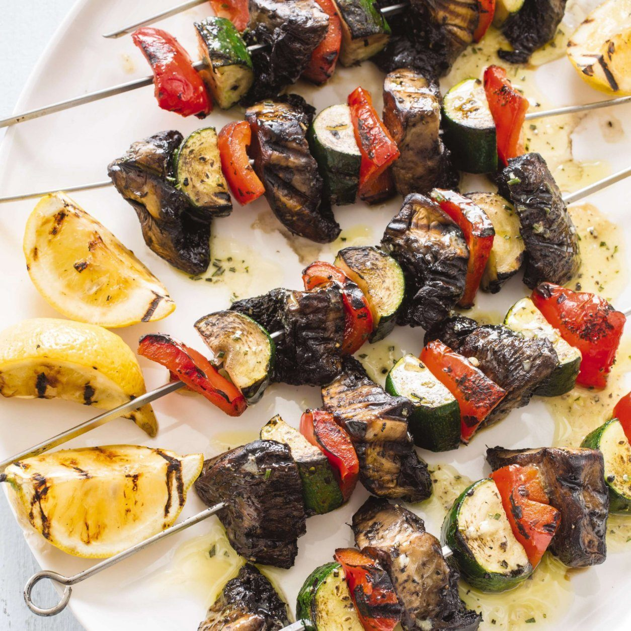 """This undated photo provided by America's Test Kitchen in May 2019 shows Grilled Vegetable Kebabs in Brookline, Mass. This recipe appears in the cookbook """"Master of the Grill."""" (Daniel J. van Ackere/America's Test Kitchen via AP)"""
