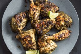 """This undated photo provided by America's Test Kitchen in May 2019 shows Jerk Chicken in Brookline, Mass. This recipe appears in the cookbook """"Vegetables Illustrated."""" (Steve Klise/America's Test Kitchen via AP)"""