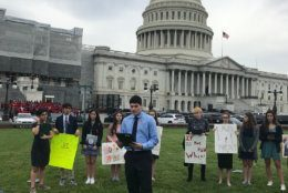 The group from Temple Emanuel, in Kensington, read the names of students who were killed last year at U.S. schools and held a moment of silence in front of the U.S. Capitol. (WTOP/Mitchell Miller)