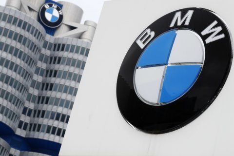 BMW profit hit by anti-trust case, spending on  technology