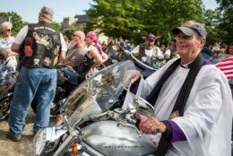 "WASHINGTON, DC - MAY 24: The Rev. Stuart Kenworthy sits on a motorcycle during a blessing of the bikes event at the Washington National Cathedral on May 24, 2019 in Washington, DC. Rolling Thunder will mark the 32nd anniversary of its annual ""Ride for Freedom"" motorcycle procession and commemorative events this Memorial Day weekend for raising the attention of POW and MIA issues (Photo by Zach Gibson/Getty Images)"