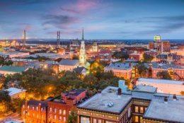Savannah, Georgia, USA downtown skyline at dusk.