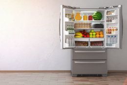 Open fridge  refrigerator full of food in the empty kitchen interior. 3d Illustration