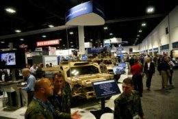 TAMPA, FL - MAY 23:  Attendees inspect the latest military technology and gear, including the Flyer 72 Lightweight Ground Mobility Vehicle by General Dynamics, during the Special Operations Forces Industry Conference (SOFIC) on May 23, 2018 in Tampa, Florida. SOFIC allows industry participants opportunities for networking, business intelligence, brand promotion and product demonstration as well as tips on how to do business with the U.S. Special Operations Command. (Photo by Brian Blanco/Getty Images)