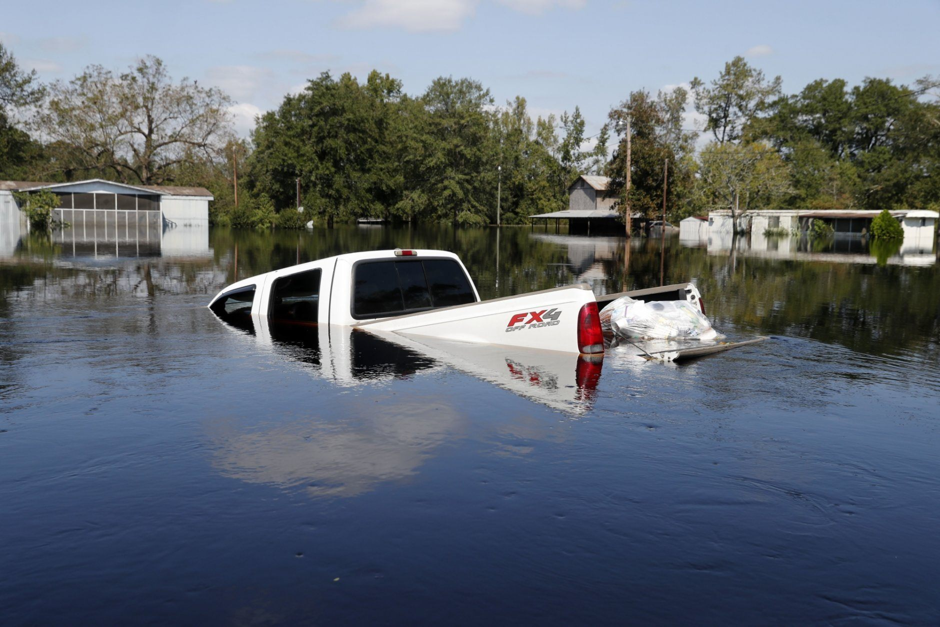FILE - In this Sept. 21, 2018, file photo, a submerged truck sits in floodwaters in the aftermath of Hurricane Florence in Nichols, S.C. Nichols suffered devastating flooding during Hurricane Matthew 2016 and Florence in 2018. (AP Photo/Gerald Herbert, File)